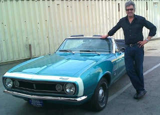 Dennis buys Classic American cars like this Camaro