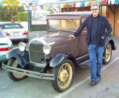 Dennis Goddard Standing next to Model A Ford he just paid cash for this car